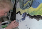 Volunteer paints ceiling tile at Sunnybrook