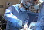 Surgeon performing prostate cancer surgery
