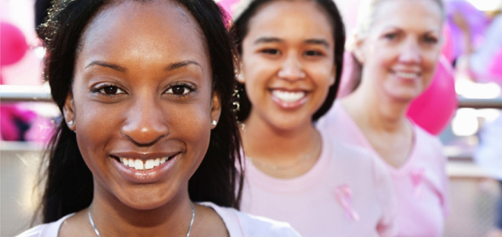Women in pink smiling