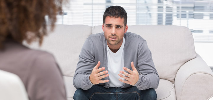 Man participating in talk therapy