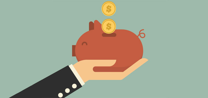 Holding a piggybank, saving money