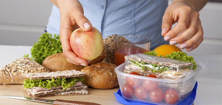 Woman packing a healthy lunch