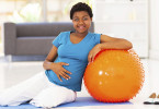 Pregnant women sitting with exercise ball