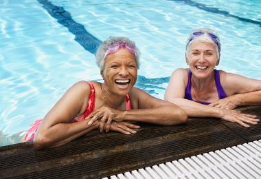 Older couple swimming
