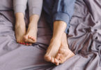 a couple's feet in a bed