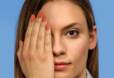 Woman covering eye