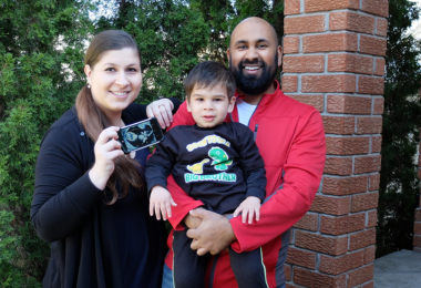 Anna Jodhi, her husband and son show off a sonogram of her second baby
