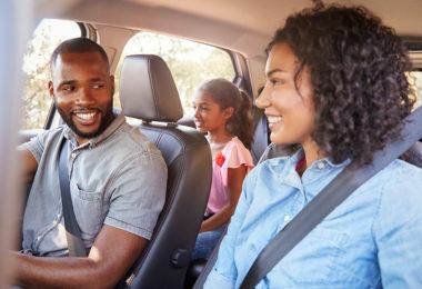 Family wearing seatbelts in a car