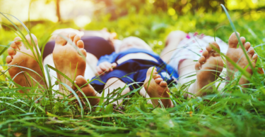 feet of family in the grass, summer picnic