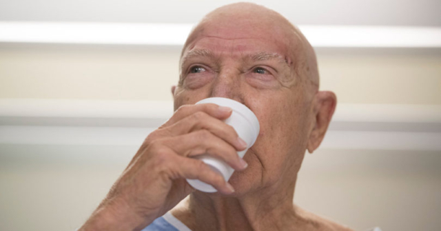 Patient drinks water for the first time since he was diagnosed with essential tremor