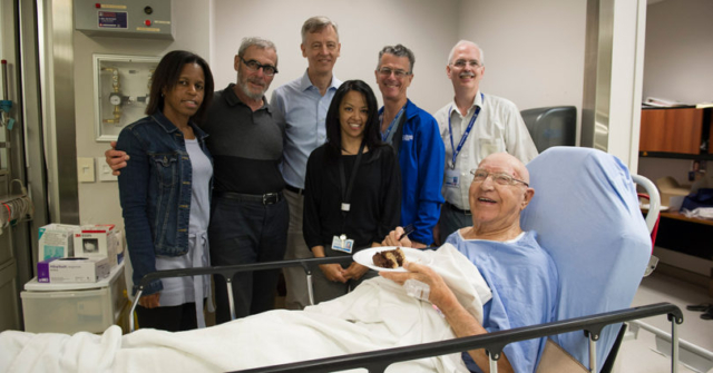 Patient and care team celebrate the 100th focused ultrasound treatment for essential tremor with cake!