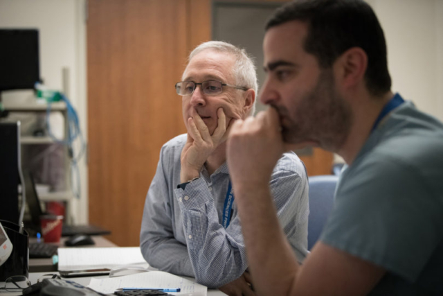 Study co-investigators Dr. Anthony Levitt (left) and Dr. Nir Lipsman oversee Linda's procedure.