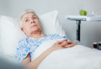 Senior woman in bed