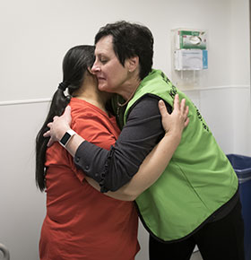 France gives a hug to patient, Mary Ybanez.
