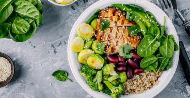 Bowl with vegetables, chicken, beans and quinoa