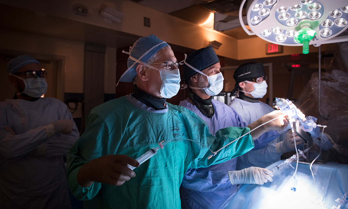 Dr. Eric Cohen (left), Dr. Gideon Cohen and Dr. Andrew Czarnecki perform a mitral valve replacement