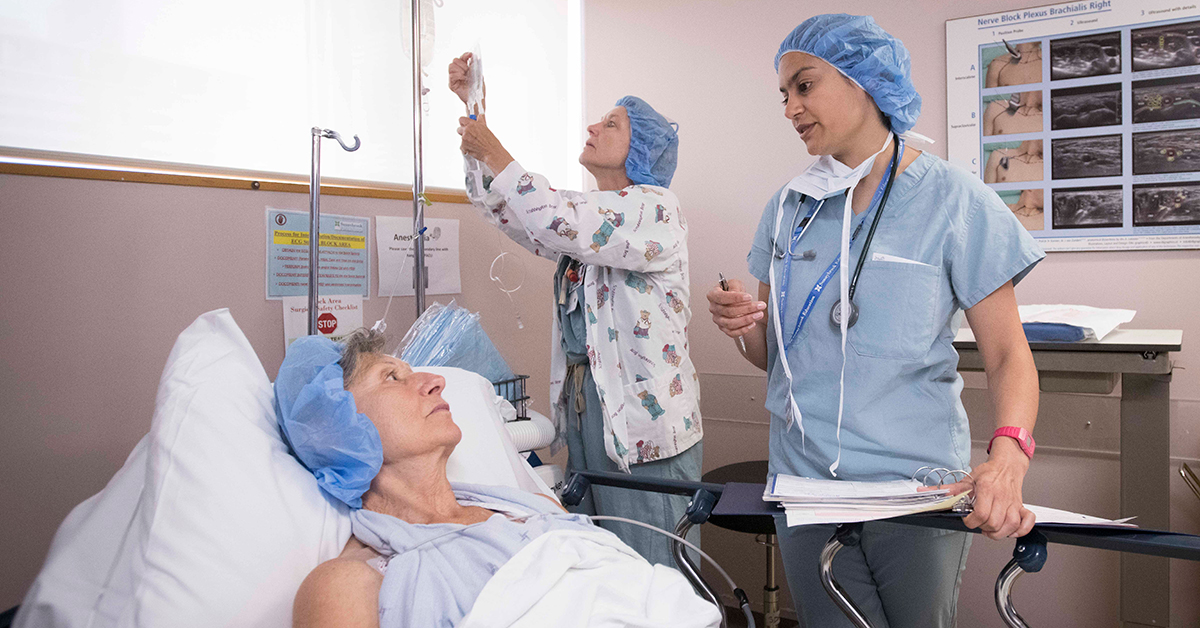 "A nurse checks the patient into the ""block"" area"