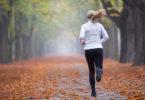 A woman runs down a pathway.