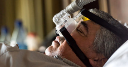 man with sleep apnea machine