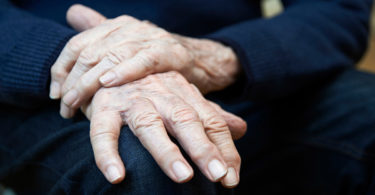 The hands of an elderly person.