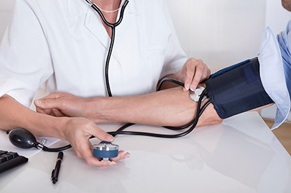 A person gets their blood pressure checked