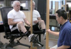 Man participating in mirror therapy for phantom limb