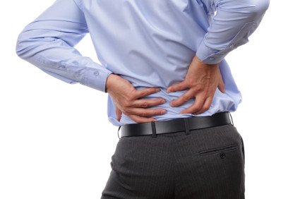 Man holding low back in pain