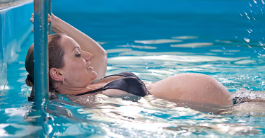 woman exercising in the pool while pregnant
