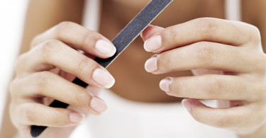 close-up of a woman filing her nails