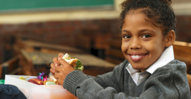 girl eating lunch at school