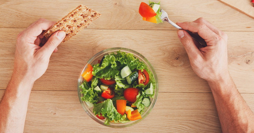 Business person eating healthy lunch