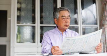 Senior reading newspaper