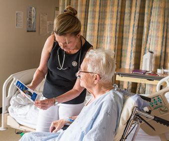Nurse Practitioner Deborah Brown discusses Keeping a Healthy Mind with a patient, part of the Anti-psychotic Stewardship Program.