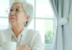 Senior woman sitting alone with a coffee
