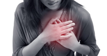 Woman having heart attack