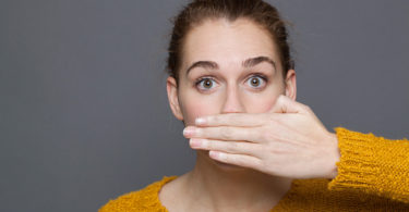 Woman covering up her bad breath