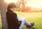 woman reading outside
