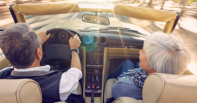 Two elderly people in a car
