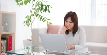 Woman reading electronic health records