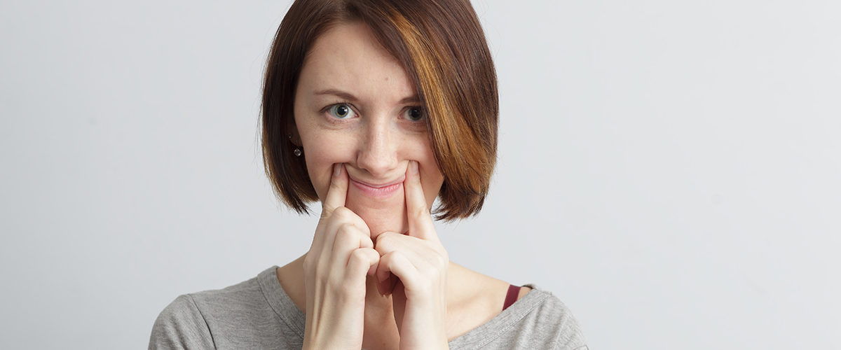 young woman trying to smile
