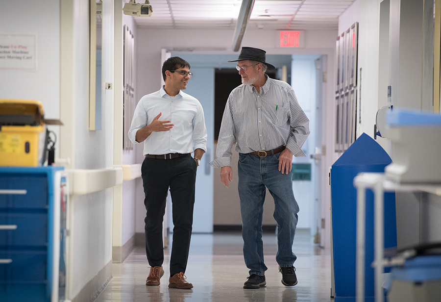 Radiation oncologist Dr. Arjun Sahgal (left) with Andrew Stewart