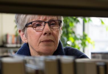 Woman looking through medicine cabinet