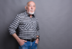 older man with hands in pockets