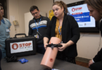 Participants at a Stop the Bleed course, which teaches first responders how to deal with uncontrolled bleeding in trauma victims.