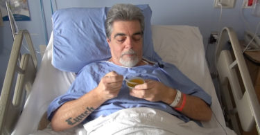 Patient Doug Lynch eating Jell-O
