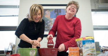 Cancer survivor Nettie Yeoman (right) bakes cookies with occupational therapist Beverley Moskovic at Sunnybrook's W.P. Scott Geriatric Day Hospital.