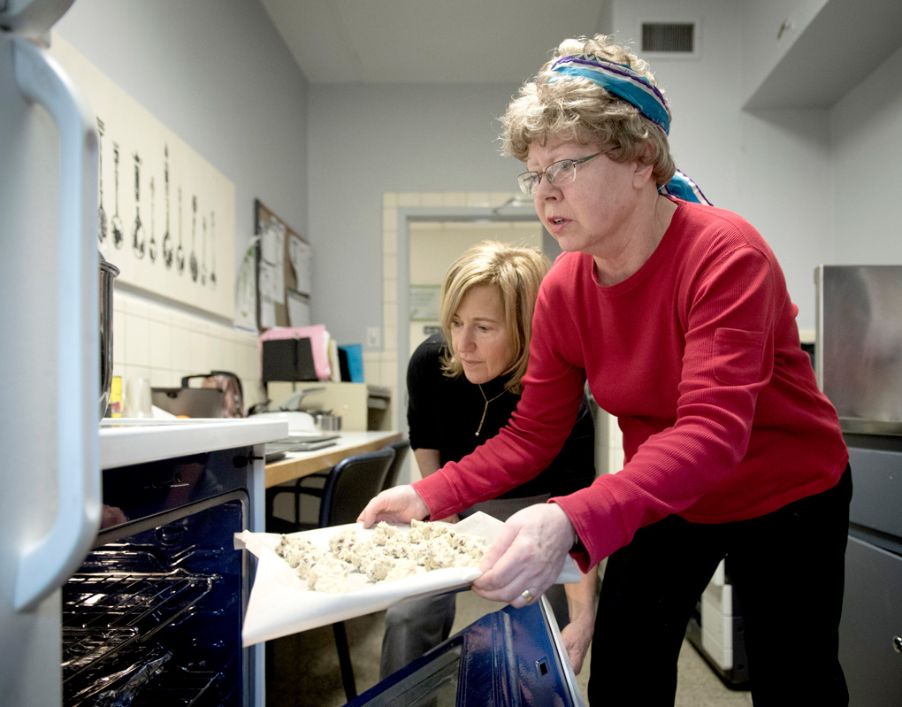 Nettie Yeoman bakes cookies with occupational therapist Beverley Moskovic at Sunnybrook's W.P. Scott Geriatric Day Hospital.