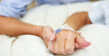 holding hands in the critical care unit