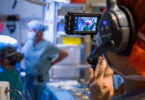 A video camera captures a live surgery.