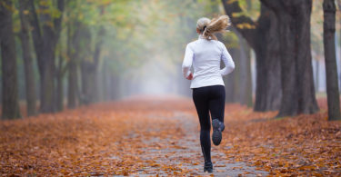 A woman runs down a pathway.